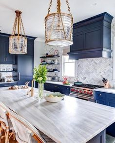 Beautiful kitchen with modern light fixtures, blue cabinets and grey backsplash . Beautiful kitchen with modern light fixtures, blue cabinets and grey backsplash and countertops Home Decor Kitchen, Home Kitchens, Blue Kitchen Ideas, Coastal Kitchens, Rustic Kitchen, Kitchen Grey, Gold Kitchen, Stone Kitchen, Country Kitchen