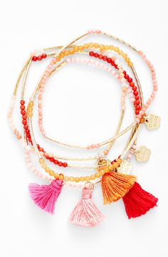 The soft, vivid tassels add total statement quality to these fun stackable bracelets.