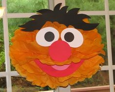 """Orange Monster tissue paper pompom kit, inspired by """"Ernie"""" from Sesame Street. $9.99, via Etsy.  This site has all the characters...If I have time I may try DIY on this!"""