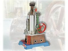 """The Wilesco D455 Steam Engine Vertical with mirror polished and nickel plated boiler, it has a diameter of 2.6"""", height 6.9"""", boiler capacity 30.5 in, with single boiler flue of 0.8"""" diameter, built into the boiler to improve efficiency and for steam exhaust, with elongated water gauge glass.  Boiler house true to life, colored and copper plated with embossed brick type walls.  Footbridges with railings and ladder.  Spring loaded safety valve, dome whistle, steam regulator and steam jet oiler."""