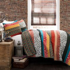 Add a burst of bohemian, chic color to your bedroom decor with this 3-piece quilt set. Crafted with pure cotton for comfort, this eye-catching striped bedding is bursting with colorful floral and geometric patterns.