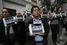 Journalists and supporters of press freedom hold signs reading 'Je Suis Charlie (I Am Charlie)' in Hong Kong in tribute to the victims