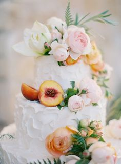 Gorgeous wedding cake decorated with fruit and flowers. #peach #wedding #cake