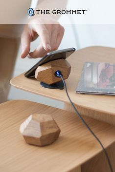 Power up with a wooden wireless charger and stand that is as attractive as it is fast. It's crafted in Latvia from oak or Zebrano wood that's shaped to hold a phone at the just-right angle to view and use without holding it. A million micro suction cups grip a phone to the 10-watt Qi compatible charging pad. This gorgeous charging stand is the perfect addition to your home office or gift for your tech-saavy yet stylish friend! Cool Tech Gadgets, Cool Technology, Power Led, Charger, Cups, Cool Stuff, Stylish, Phone, Wood