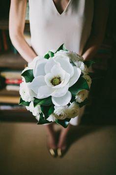 A large magnolia, verdant leaves, and gardenias in this beautiful bridal bouquet   Photo by Joshua Kane Photography via http://junebugweddings.com/wedding-blog/intimate-wedding-ann-norton-sculpture-gardens/