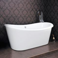free standing bath against a feature wall