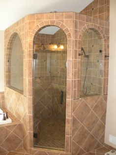 Our master bath shower is about this size. How awesome it would be to have the stone work like this around it.