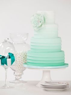sea foam green ombre wedding cake. Dont like the flower but the rest is neato looking
