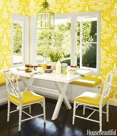 Black-painted wood floors set off the sunny lemon wallpaper and crisp white accents.