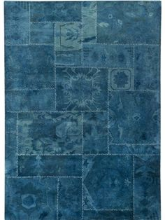 Sarangi - Turquoise is a hand tufted, hand-stitched rug that is made of 100% wool. This rug embodies the concept of recycling. It is not made of new yarn, but  made using the left over yarn from other rugs that has been re-dyed/over-dyed. Made in India.