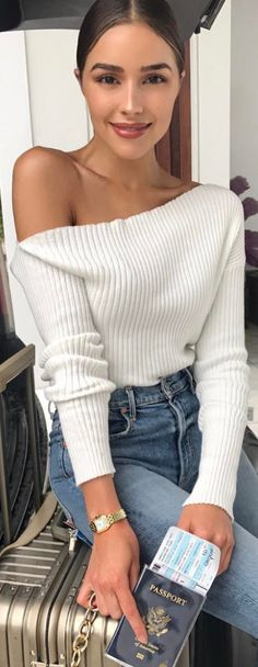 Who made Olivia Culpo's white off the shoulder sweater?