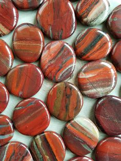 "Rainbow Red Jasper - Pocket Stones Each pocket stone is about 1.5 inches Metaphysical Properties: ""Red Jasper carries a strong spiritual grounding vibration, and resonates within the lower three chakr"