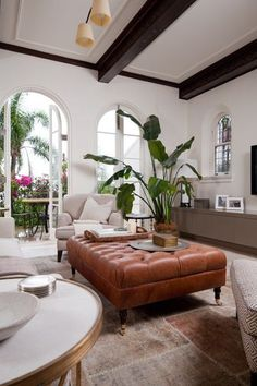With ideas of cozy dancing in my mind for my living room, I stumbled across a living room designed by Coco Republic Interior Design and quickly took note. From the tufted ottoman (you can find affo…