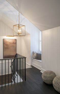 Simple yet stunning staircase landing with white shiplap walls and a built-in window seat | Cameron & Cameron