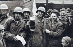 Soldiers of the US Army share a drink with civilians during the liberation of Pilsen, Czechoslovakia in 1945.
