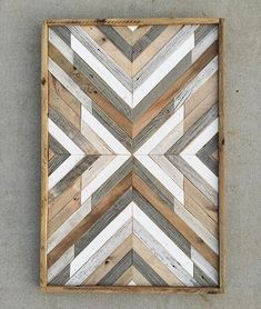 Love the contrasting mix of cool greys with warm natural wood tones in this piece! Happy Hump Day!