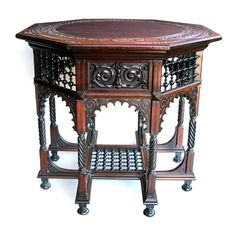 an unusual american aesthetic movement moresque inspired mahogany octagonal center table; circa 1900