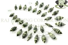 Green Zebra Jasper Faceted Dew Drops (Quality A) Shape: Dew Drops Faceted Length: 18 cm Weight Approx: 16 to 18 Grms. Size Approx: 6x13 to 8x20 mm Price $33.00 Each Strand
