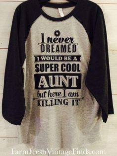 """""""I Never Dreamed I'd Be A Super Cool Aunt But Here I Am Killing It"""" printed baseball t-shirt, soft fabric. These shirts are true to size with loose sleeves. Sizes Width (IN) Length (IN) XS 16 26 S 18 27 M 20 28 L 22 29 XL 24 30 26 31 Aunt T Shirts, Tee Shirts, Printed Shirts, Cool Shirts, Funny Shirts, Fashion Art, Diva Fashion, Boho Fashion, Fashion Ideas"""