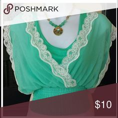 MINT AND CREAM LACE BLOUSE NWT HAS A GATHERED AND STRETCHY WAISTLINE. SHEER ON TOP AND A SOLID ATTACHED TANK UNDERNEATH. MAKE ME AN OFFER AND ASK QUESTIONS BELOW! Xoxo Tops Blouses