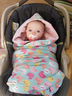 cool idea! I was wondering how you put the baby in and buckle them up but it's attached. Doing this with my next baby. No more throwing off blankets or getting them in and out of coats!