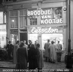 "1953. View of sandwich shop Broodje van Kootje at the Leidseplein in Amsterdam. Ko Kalra established in 1937 a sandwich shop under the name ""Populair"" on the Leidseplein 20. After World War II the shop was officially named ""Broodje van Kootje"". Specialties included ""Broodje halfom"" and ""Broodje bal"". In 2006 the last shop, on Spui, was closed. Two years before the original establishment at the Leidseplein had ceased operations. #amsterdam #1953 #Leidseplein"