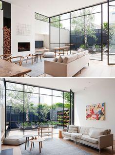 This modern living room has large floor-to-ceiling black framed windows (and a door) that flood the room with natural light and provide a view of the courtyard. #ModernLivingRoom #Fireplace #BlackFramedWindows #Windows