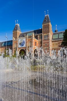 Fountains and Rijksmuseum Amsterdam Netherlands  http://www.alamy.com/mediacomp/imagedetails.aspx?ref=H2TF7A amsterdam architecture art attraction beautiful blue brick building built city culture cultures day destination destinations dutch europe european exterior famous fountain fountains heritage historic historical history holland house landmark museum