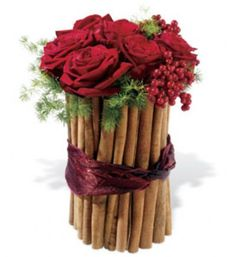 Sweet Cinnamon Delight   FF200      The sweet scent of cinnamon delights the senses! Red roses and winter berries are nested in a glass vase surrounded by sticks of cinnamon.     https://www.4165flower.com/index.asp?pid=4=viewproduct=9774=1