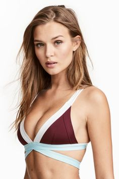 065da97e16f Triangle bikini top with decorative straps at lower edge. Lined cups, wide