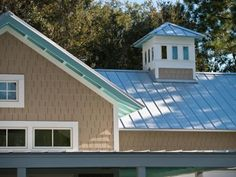 A contemporary interpretation of the classic Florida shingle-style vacation home, HGTV Smart Home 2013 boasts architectural details that harken back to Jacksonville Beach's earliest days. Cupolas, shakes fashioned from fiber cement, wraparound porches and sloped roofs recall early design.
