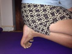 Tuck your toes and sit back on your heels in order to stretch the bottoms of your feet.
