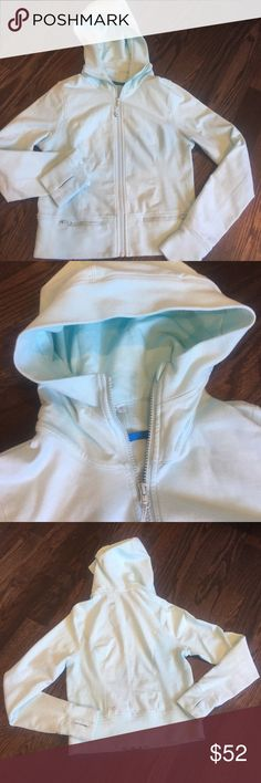 "Aqua blue Lululemon hoodie sweatshirt 8 GUC This is a beautiful Aqua blue hoodie from Lululemon that is very gently used. Old school style but in excellent condition, worn rarely! There are 2 horizontal front zippered pockets, thumbholes in sleeves. Soft but thick, fitted style with defined curves. Color shown best in pic1&4, it is a true light Aqua or light Robins egg blue. Very little piling no stains or tears, not faded. 18"" at underarms, 20"" long. Front zipper features removable…"