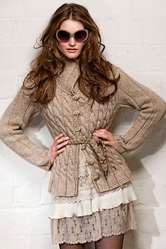 Cabled sweater coat  Color as shown  Sizes listed  Belt not included  6 buttons  Material: wool blend  Care: hand wash, dry flat