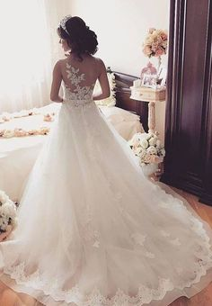 Stunning sleeveless sheer back wedding dress with floral appliques; Featured Dress: MillaNova
