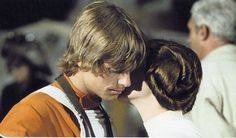 Leia kisses Luke before Yavin battle.
