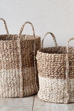 Delicatey hand woven from water hyacinth, this basket works perfectly in any space in the home. Lined Wicker Baskets, Wicker Baskets With Handles, Rattan Basket, Wood Railings For Stairs, Dog Stairs, Stair Basket, Storage Baskets With Lids, Water Hyacinth, Bohemian Decor