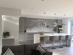 A stunning grey gloss kitchen designed, supplied and fitted by Kitchen Ergonomics. This beautiful kitchen is fitted with top of the range Neff appliances and a stunning quartz worktop.