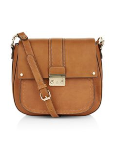 Create a vintage aesthetic with our seventies-inspired Avery saddle bag, designed with front flap with a tab detail and gold-tone metal clasp. It's just the ...
