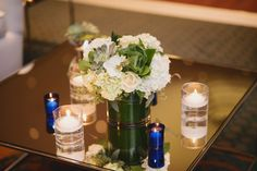 We love this modern floral design. The mirrored tables and candles add an elegant ambiance we adore.