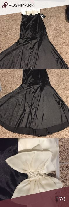 Formal dress Black and white very elegant dress. Stripless. New w tag never worn . Size 10 from Nordstrom JS Boutique Dresses Prom