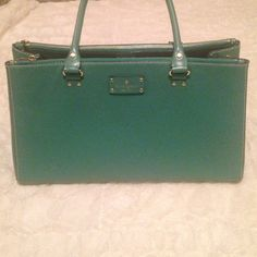 Kate spade bag! Adorable Kate spade bag with tons of storage space! Main area with 2 side zipper pockets, able to fit so much stuff! Love this bag but really need to let it go ( grad school is expensive!!) kate spade Bags Shoulder Bags