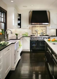 polished black lamitate flooring complement the design of this art deco kitchen