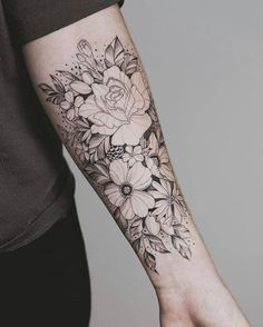 amazingly detailed floral forearm tattoo in black ink with white detailing, pin: morganxwinter