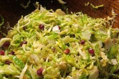Brussels Sprouts Slaw with Pine Nuts and Pomegranate -- adapted from recipe in February Food & Wine -- big hit!
