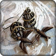 Set Free: antiqued brass bird cage and bird charm earrings