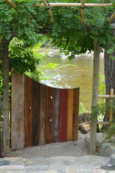 Reclaimed wood garden gate leading to the Truckee River at SierraWaterGardens.com.