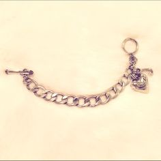 Juicy Couture Silver Charm Bracelet This is a juicy couture charm bracelet that has never been worn! It is silver and comes with an attached heart charm. I have multiple other charms listed in my closet that would be perfect for this bracelet! Juicy Couture Jewelry Bracelets