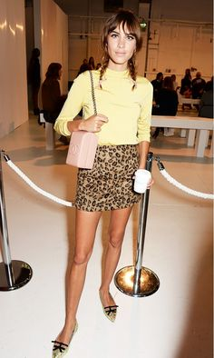 Alexa Chung pulls off a leopard skirt with a yellow jersey sweater and metallic flats.