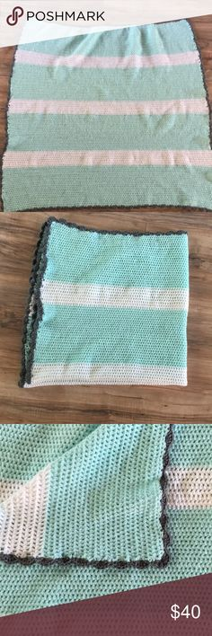 Medium sized crocheted baby/toddler blanket White, mint green, and dark gray border. Just made. Never used. Perfect throw for crib or lounging. Made with acrylic yarn. Can be machine washed. One edge is tight as shown in pictures. Needs to be stretched out a bit. Gender neutral. Other